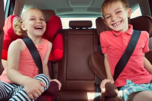 Boy-And-Girl-In-Car-Seat
