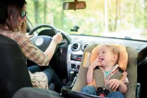 Woman-Driving-With-Baby-In-a-Car-Seat